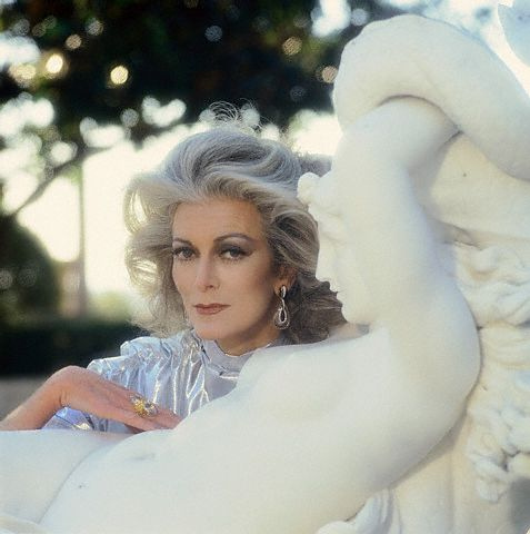 ca. May 1981, Hearst San Simeon State Historical Monument, California, USA --- Carmen Dell'Orefice and Statue --- Image by © Norman Parkinson/Sygma/Corbis